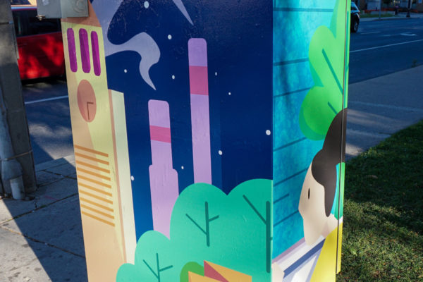 Mural painting on electrical box along the street.