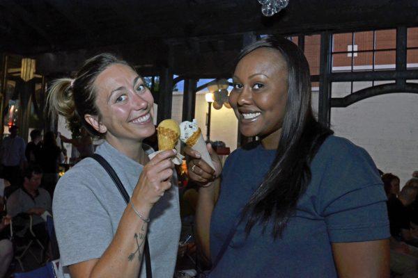2018 movie night at Ferguson Station. Women smiling enjoying ice cream.