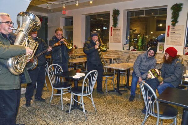 2018 Victorian Night. Festive band playing for people inside of Denniger's Foods of the World