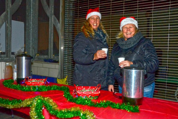 2018 Victorian Night. Women handing out hot chocolate at Ferguson Station..