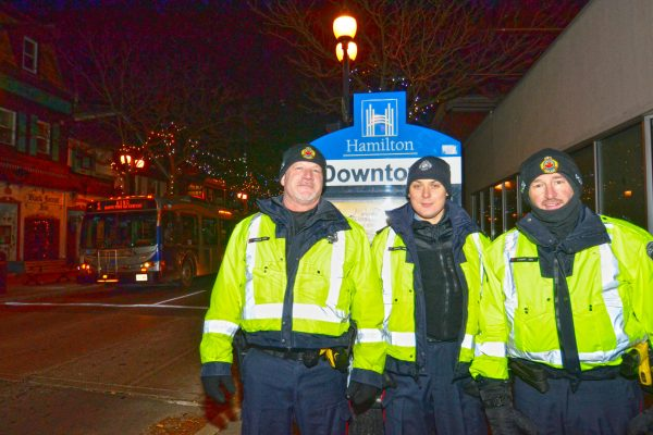 2018 Victorian Night. Police officers posing for a picture together on King street east under the holiday lights.