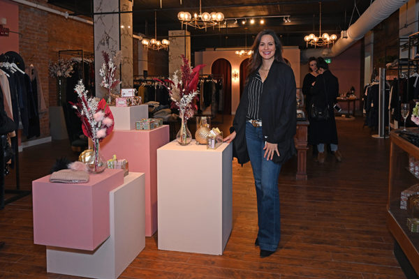 2019 Victorian Night. Woman smiling inside Luv La Vie store.