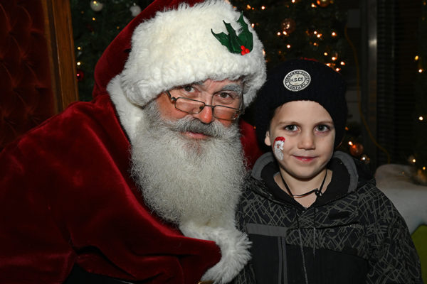 2019 Victorian Night. Child smiling with Santa Claus.
