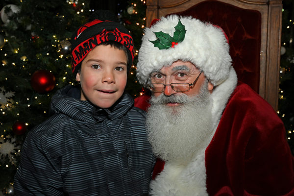 2019 Victorian Night. Child smiling next to Santa Claus.