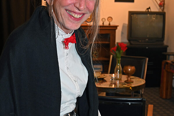 2019 Victorian Night. Woman smiling in Victorian outfit.