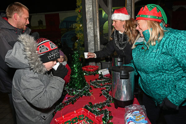 2019 Victorian Night. Hot chocolate being handed out to group of people.