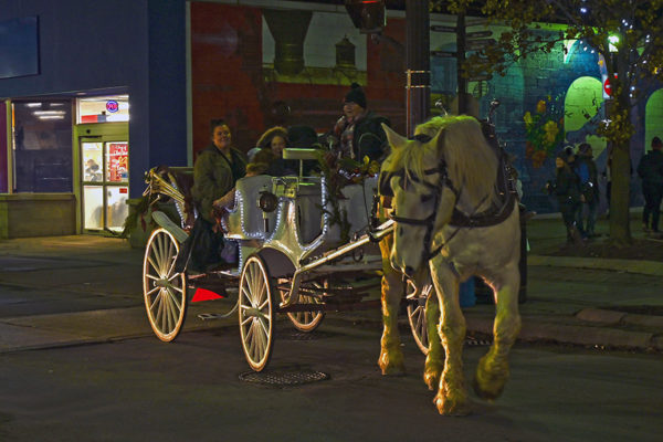 2019 Victorian Night. Group of people enjoying a ride on a horse drawn carriage.