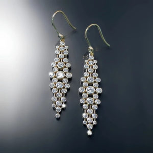 Pair of Cubic Zirconia earrings Set in gold vermeil. Sterling silver base with gold overlay.