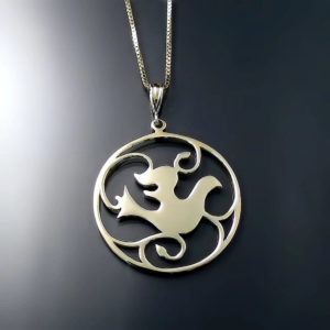 Yellow Gold Dove Pendant. This graceful medallion pendant is sure to become a family heirloom. Featuring a lovely Dove design surrounded by vines.