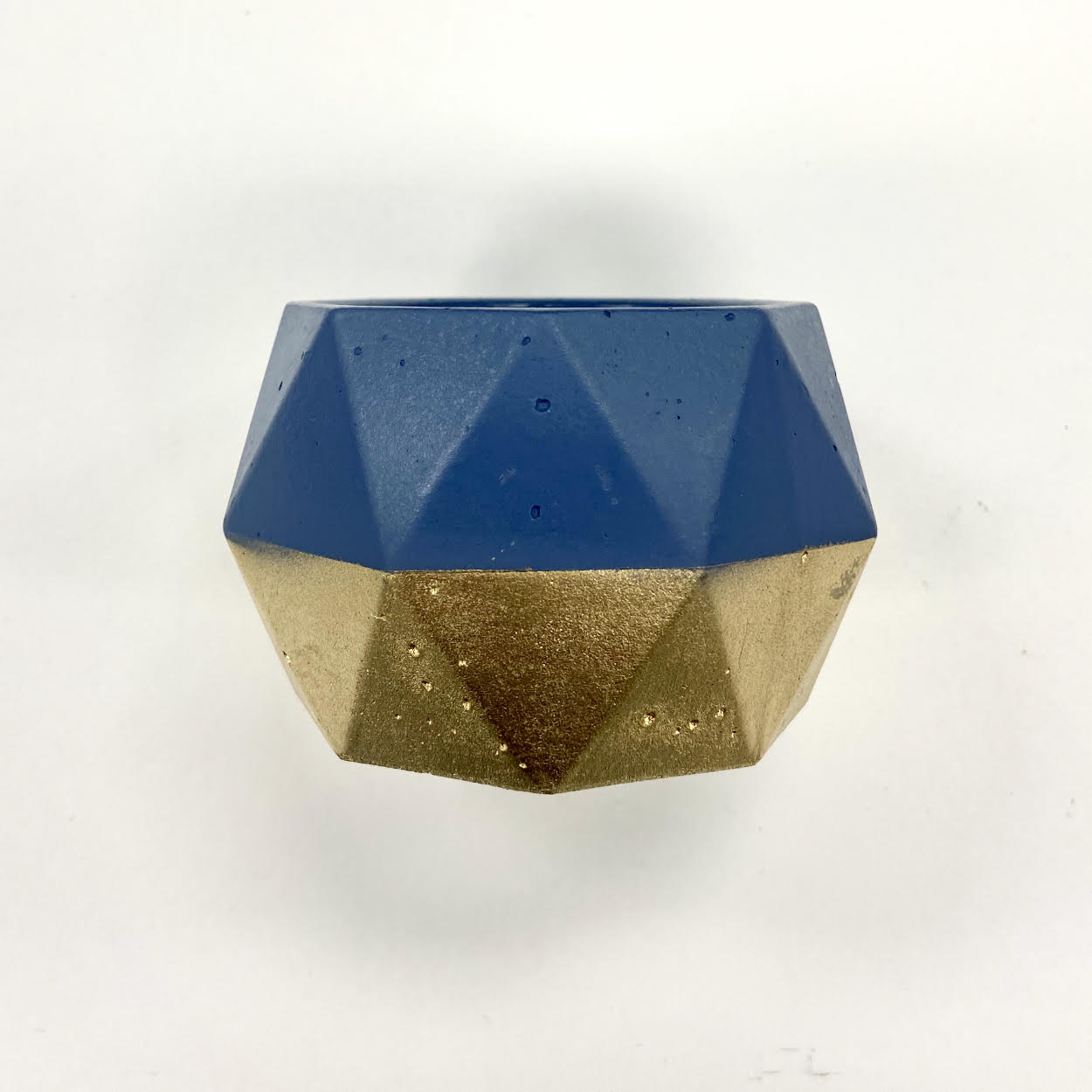 Image of a Dark Blue and Gold Geometric Candle Holder