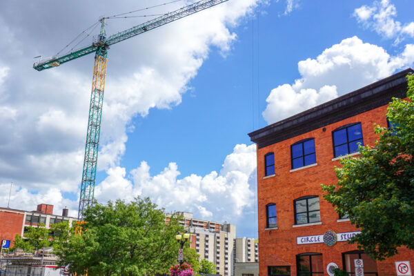 Image of construction crane in from Ferguson Ave.