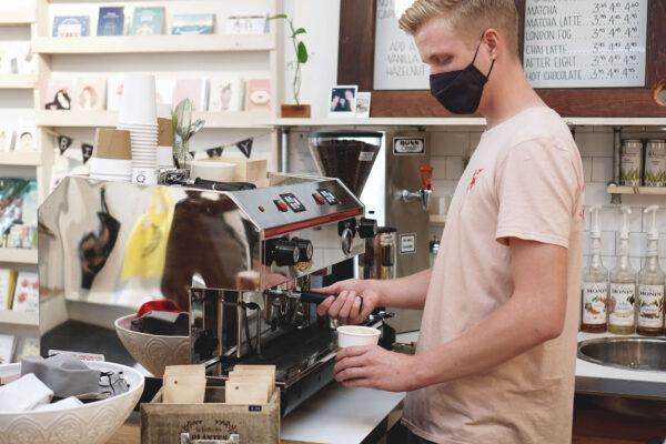 Person making latte at Studio 205