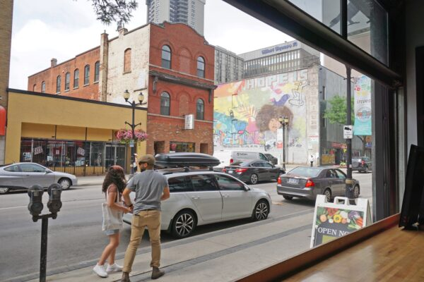 Image of the Streetscape of King Street with store and mural in the background